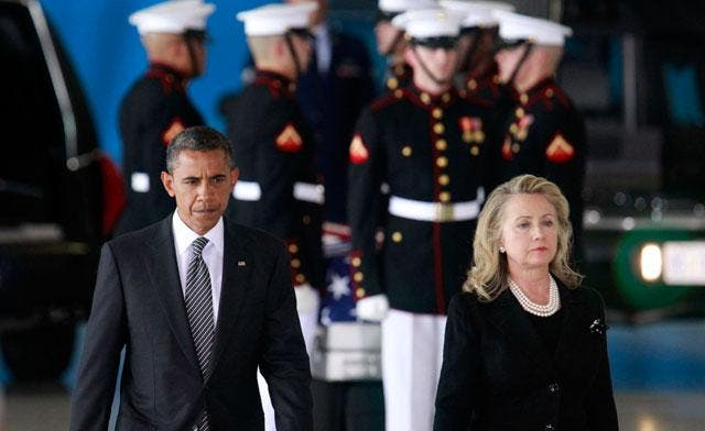 .S. President Barack Obama and Secretary of State Hillary Clinton participate in a transfer ceremony of the remains of U.S. Ambassador to Libya, Chris Stevens and three other Americans killed this week in Benghazi, at Andrews Air Force Base near Washington. (Reuters)