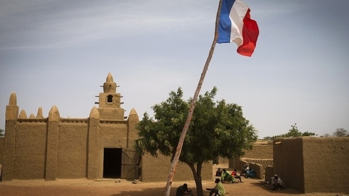 The French national flag flies outside Bore's mosque, near Mopti, on March 2, 2013. French and Malian troops have been pushing back armed Islamist militant groups for nearly two months, after they gained control of the north of the country during 2012. (AFP)