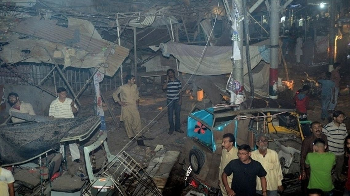 Pakistani rescuers work at the site of the bomb blast in Karachi on March 3, 2013. A bomb attack in Pakistan's largest city Karachi on Sunday killed at least 23 people, including women and children, and wounded 50 others, police said. (AFP)