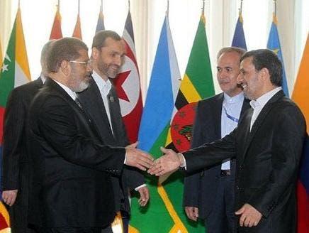 لقاء بين الرئيس الإيراني السابق محمود أحمدي نجاد والرئيس المصري المعزول محمد مرسي