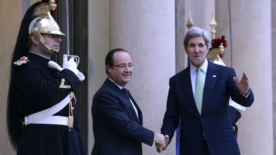 French President Francois Hollande (L) welcomes US Secretary of State John Kerry prior to a meeting at the Elysee presidential Palace, on Feb. 27, 2013, in Paris. (AFP)