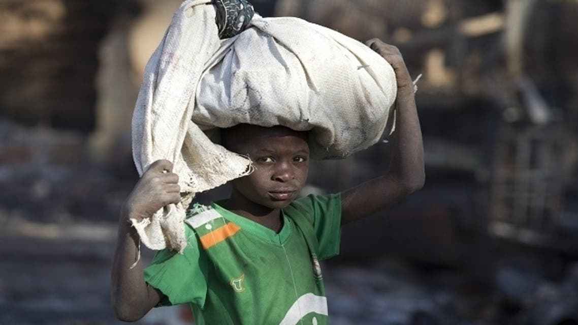 A boy carries a bag as he searches for goods on February 24, 2013 in Gao's market which allegedly burnt down following an attack by Islamist militants on February 21, 2013 in Gao. (AFP)