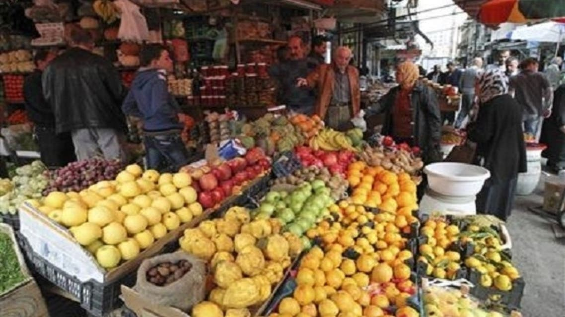 Customers buy fruits along a street in Damascus. However, there are many who feel trapped between an unloved authority in the form of the 43-year-old Assad dynasty and hungry revolutionaries at the gates, who resent the city's privileged lifestyle (Reuters)