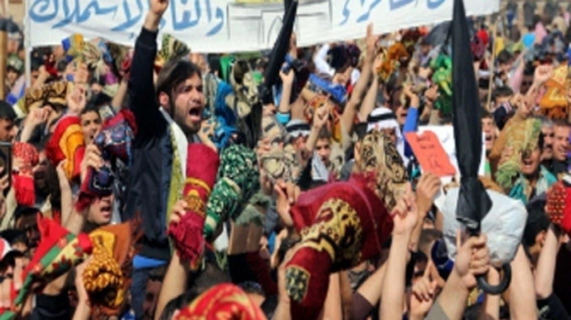 Iraqi Sunni Muslims take part in an anti-government demonstration in Falluja, 50 km west of Baghdad, Feb. 22, 2013, against Iraqi Prime Minister Nuri al-Maliki. (Reuters)
