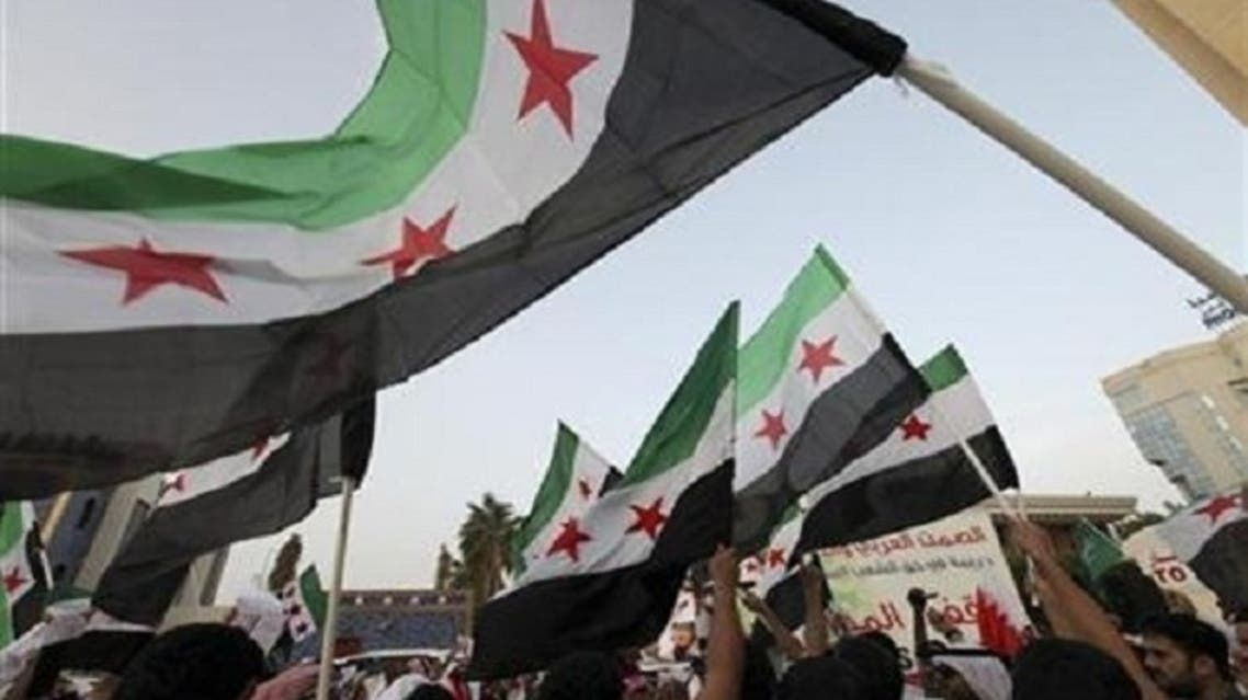 """""""The flag of the revolution will be raised above the building,"""" the Syrian National Coalition added. (Reuters)"""