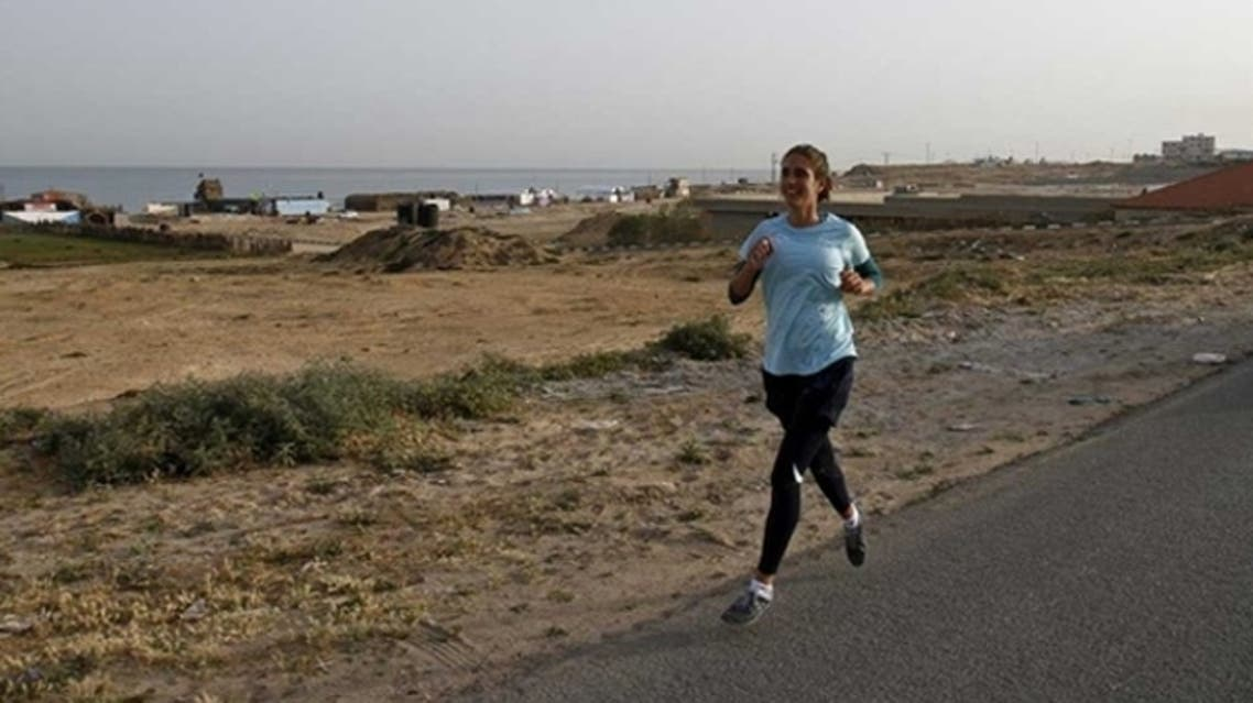 UNRWA (United Nations Relief and Works Agency for Palestine refugees) staffer Gemma Connell runs in Beit Hanun on May 5, 2011 as she competes in the Gaza Strips first-ever marathon which runs the entire length of the coastal enclave. (AFP)