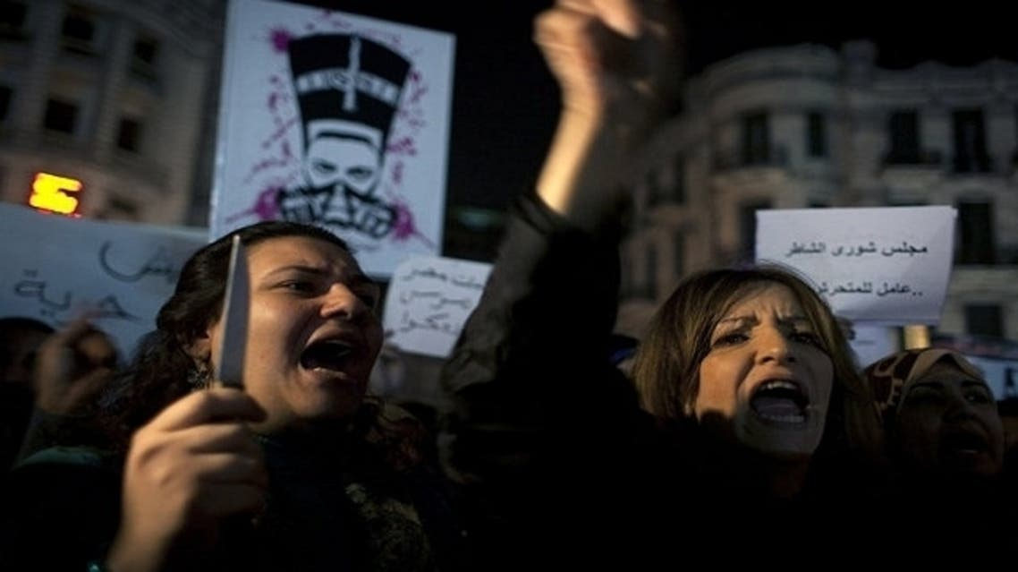 An Egyptian woman activist holds a knife while taking part in a protest for women against sexual harassment. (Photo courtesy of AP)