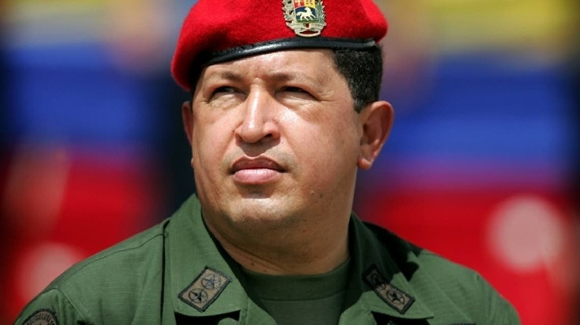 Venezuela's President Hugo Chavez wears an army uniform and the red beret of his parachute regiment while attending a military parade in Caracas in this April 13, 2005 file photo. (Reuters)