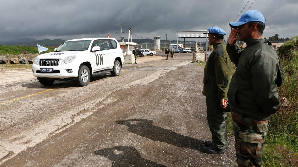 India's United Nations peacekeepers salute as a U.N. vehicle crosses from Syria into Israel at the Kuneitra border crossing on the Golan Heights March 5, 2013. (Reuters)