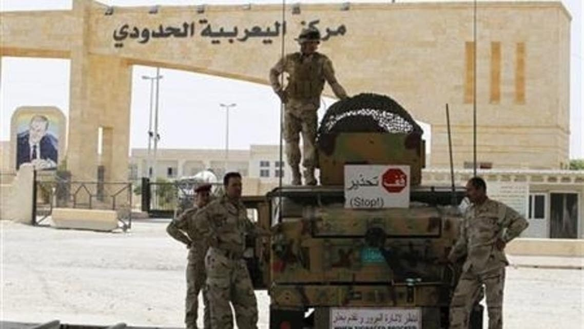 Iraqi Army personnel are deployed at the Rabia border crossing, the main border post between Iraq and Syria, July 23, 2012. (Reuters)