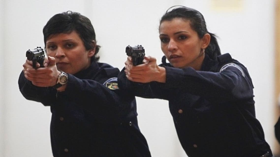 Algerian policewomen are brushing up on their shooting skills at a police training academy in Algiers. (Reuters)
