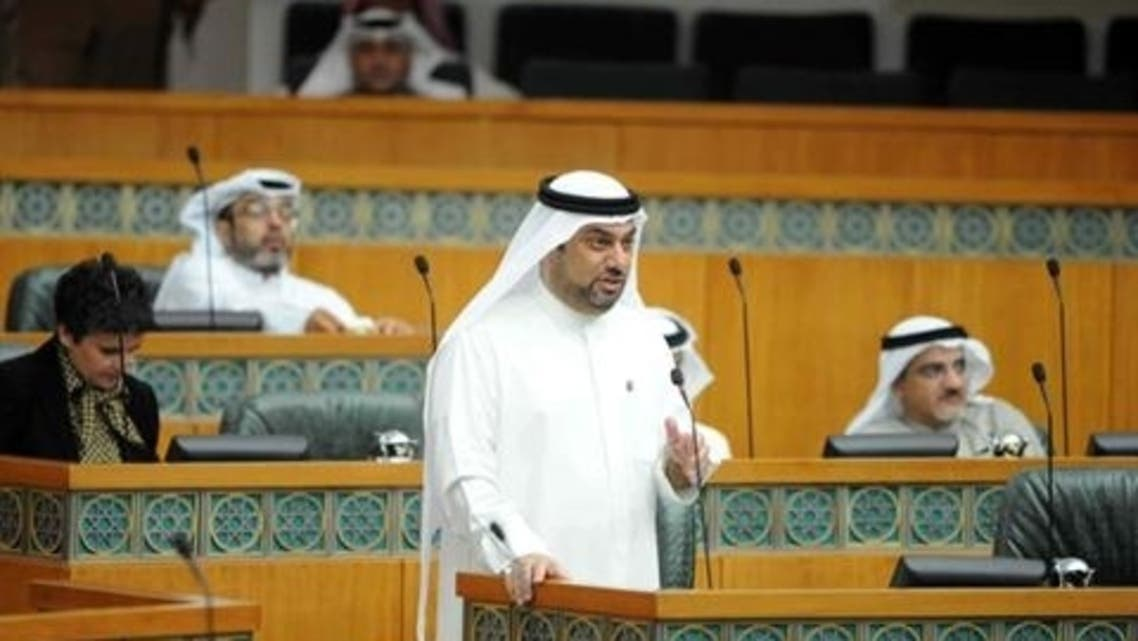 Kuwaiti MP Yousef al-Zalzalah speaks during a parliament session to discuss the delay in the building of houses in the wealthy Gulf state at Kuwait's national assembly in Kuwait City on March 7, 2013. (AFP)