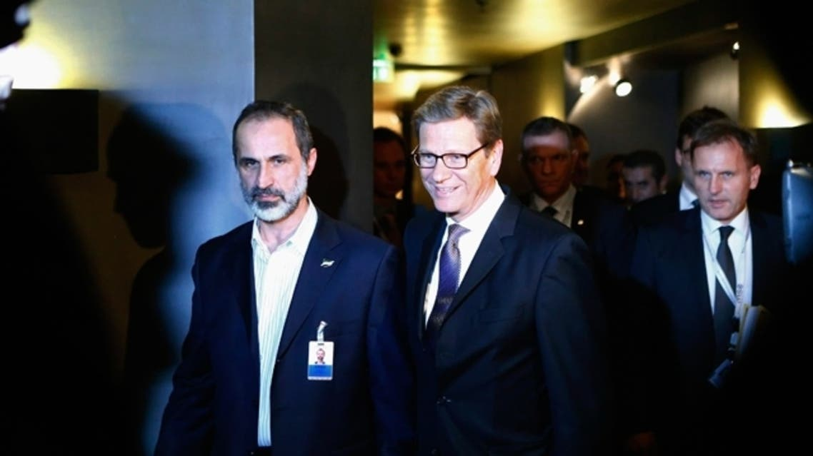 German Foreign Minister Guido Westerwelle (C) and Sheikh Moaz al-Khatib, President of the National Coalition of Syrian Revolutionary and Opposition Forces (L) arrive for bilateral talks at the 49th Conference on Security Policy in Munich Feb. 1, 2013. (Reuters)