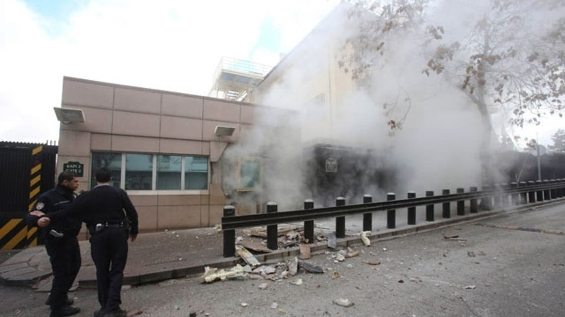 Turkish police officers react after an explosion at the entrance of the U.S. Embassy in Ankara February 1, 2013 in this picture provided by Milliyet Daily Newspaper. (Reuters)
