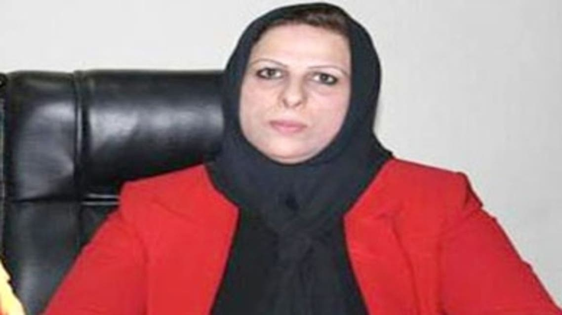 Alya Nusayf, a Member of Parliament from the Iraqi National Movement Party, threw her shoe at the head of the Iraqiya List parliamentary bloc leader, Suleiman Al-Jumaily.  Nusayf said her action was due to Jumaily's offensive language used against her. (Photo courtesay Shafaaq News)