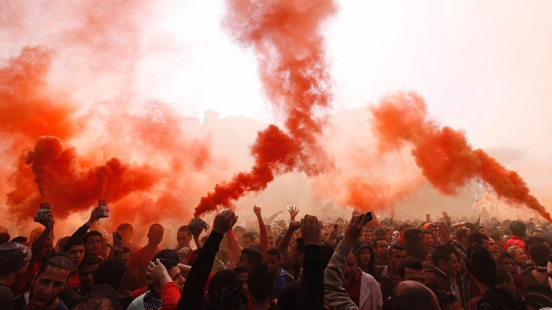 "Al-Ahly fans, also known as ""Ultras"", shout slogans against the Interior Ministry in front of the Al-Ahly club after hearing the final verdict of the 2012 Port Said massacre in Cairo March 9, 2013. (Reuters)"