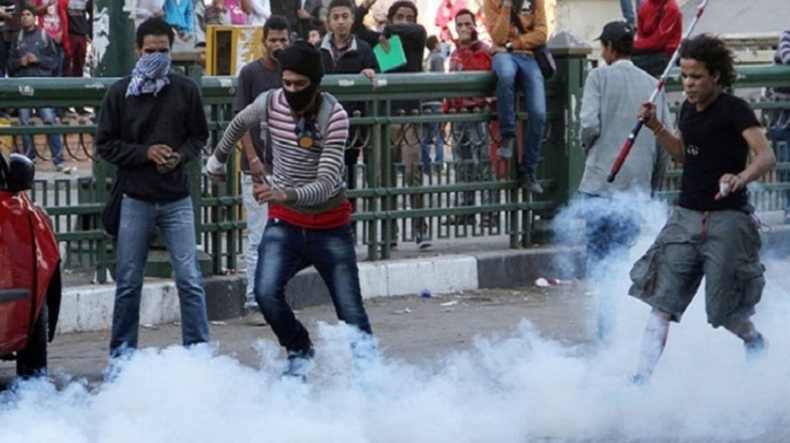 An Egyptian protester kicks a tear gas canister during clashes with Egytptian riot police in Tahrir square on November 25, 2012 in Cairo. (AFP Photo)