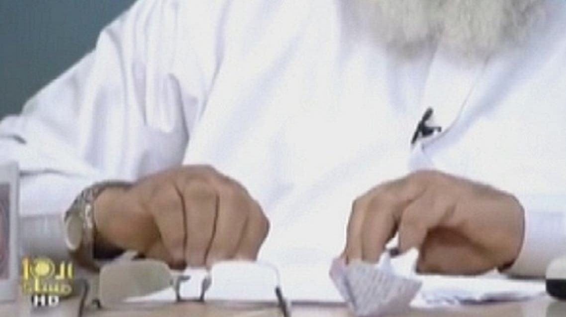 Controversial ultra-conservative preacher Ahmed Mahmoud Abdullah snubbed a debate with an Egyptian opposition political activist when he started making paper boats and taking off his shoe while on air. (Al Arabiya)