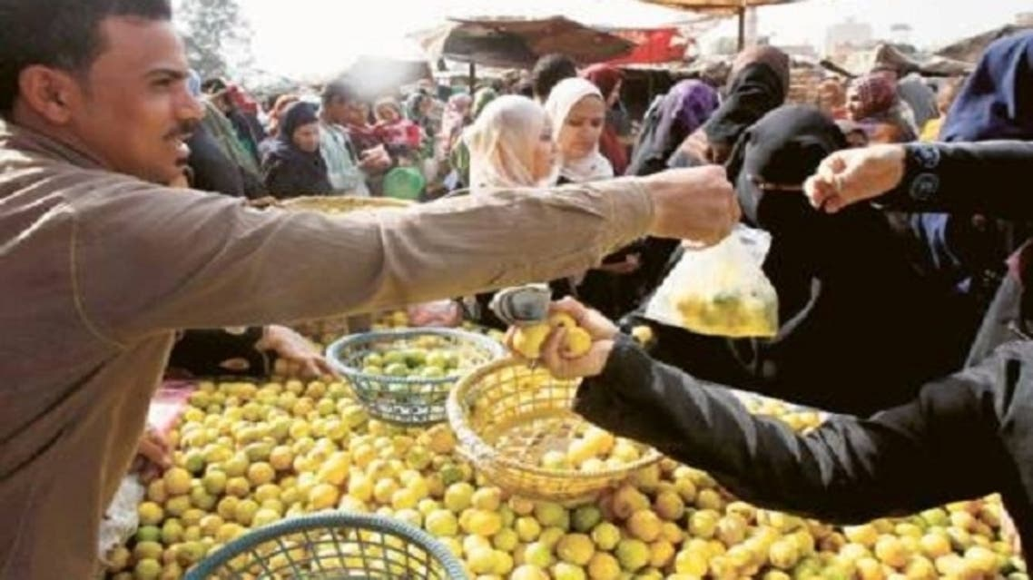 People shop at a market in Cairo. According to the statistics agency CAPMAS, Egypt's urban consumer inflation shot up to 8.2 percent in the 12 months to February as a sliding Egyptian pound pushed up food prices. (Reuters)