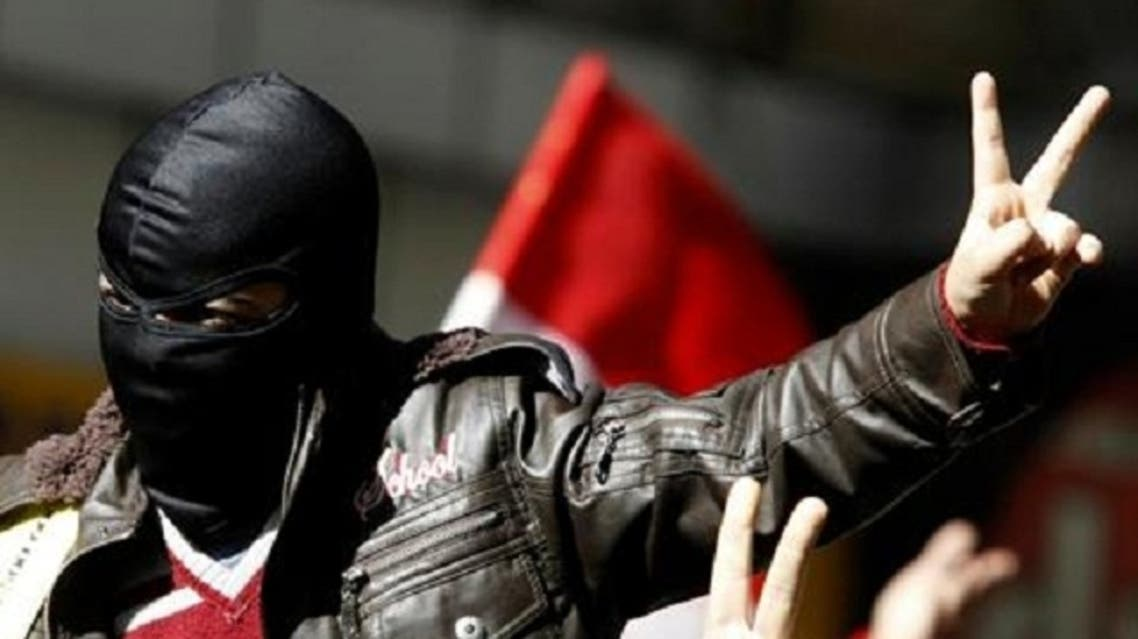 A member of the Black Bloc, who opposes Egyptian President Mohamed Mursi, gestures and shouts slogans during a protest against Mursi and members of the Muslim Brotherhood at Tahrir Square in Cairo Feb. 15, 2013. (Reuters)