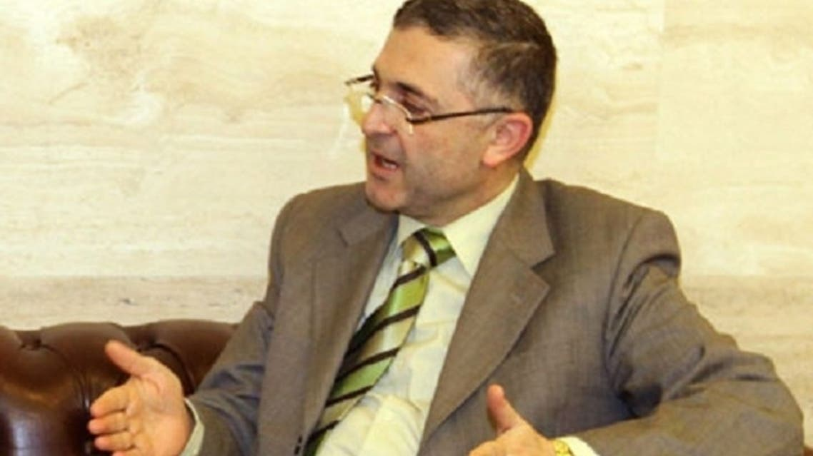 """I am willing to meet Mr. Khatib in any foreign city where I can go in order to discuss preparations for a national dialogue,"" Minister of National Reconciliation Ali Haidar told The Guardian. (AFP)"