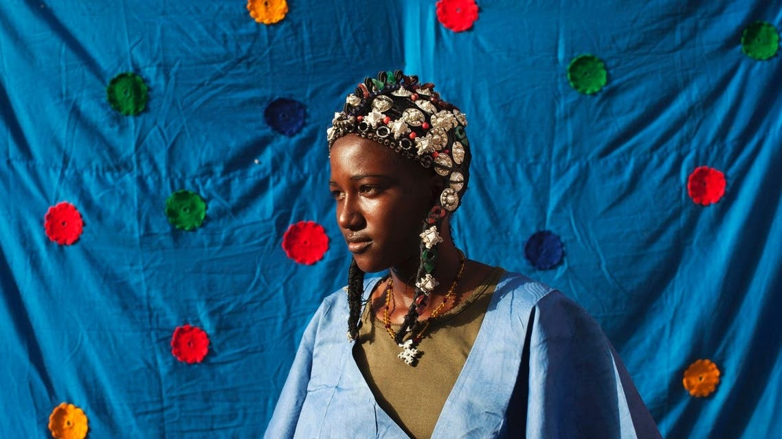 Malian artisan designs Songhai and Tuareg headdresses