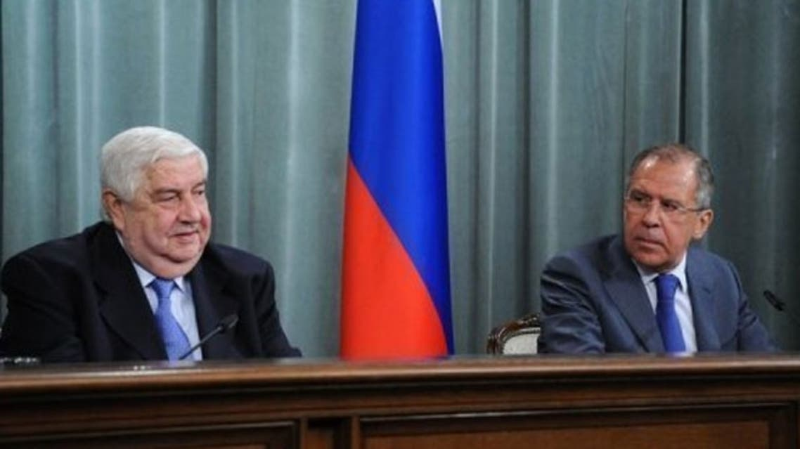 Russian FM Sergei Lavrov (R) speaks during a joint press conference with his Syrian counterpart Walid al-Moualem. (AFP)