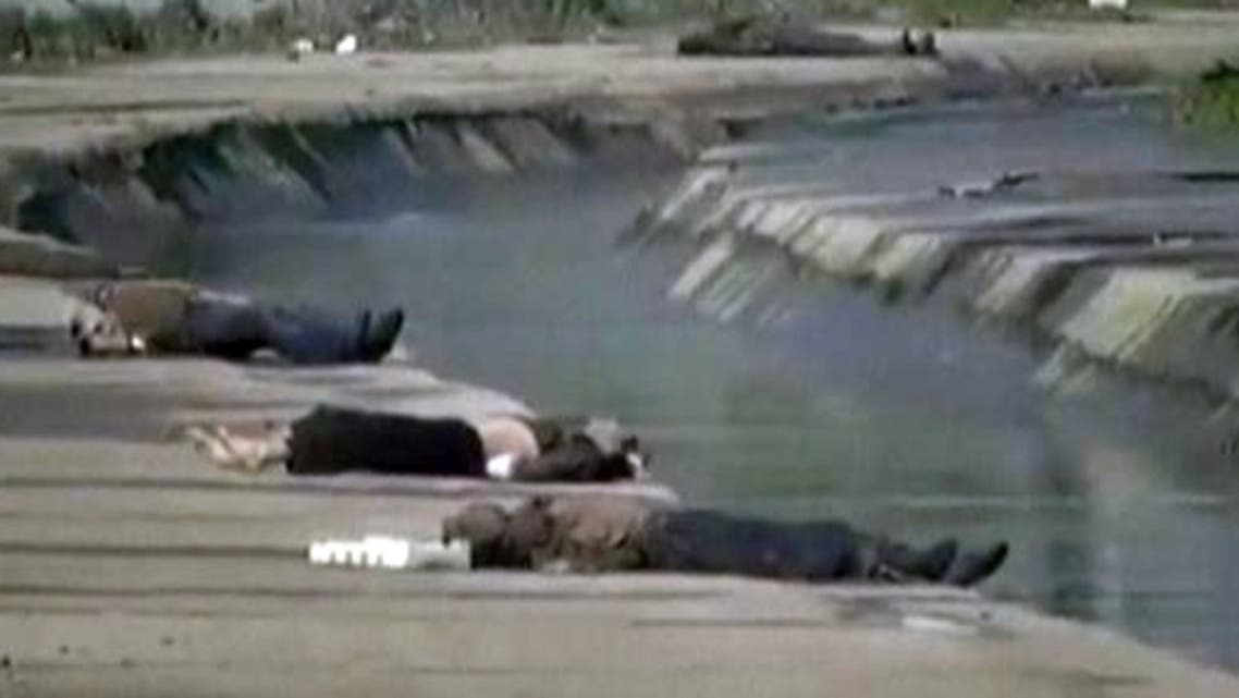 Video footage taken on Sunday, which could not be immediately verified, showed 16 bodies of young men dressed in casual clothes lying on the banks of the small stream. (Reuters)