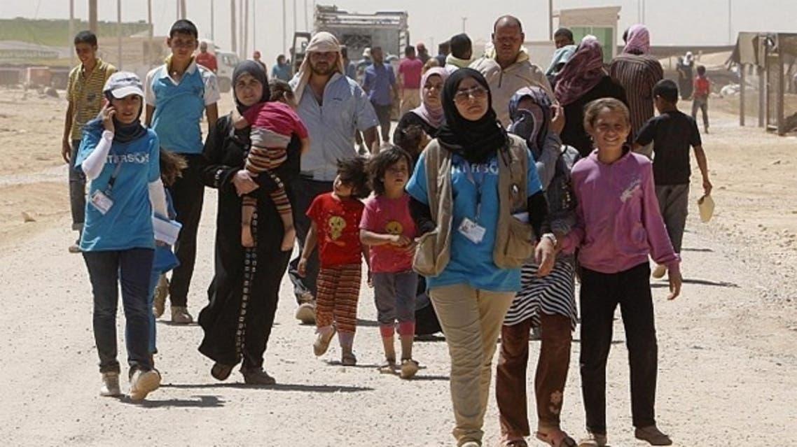 لاجئون سوريين