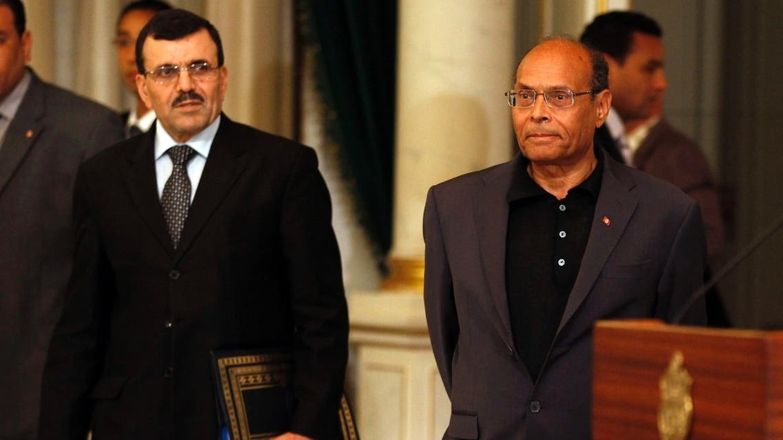 Tunisian's President Moncef Marzouki (R) arrives with Prime Minister Ali Larayedh at the swearing-in ceremony of the new Islamist-led government of office at the Carthage Palace in Tunis March 13, 2013. (Reuters)