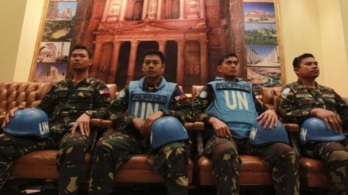 Twenty-one U.N. peacekeepers from the Philippines arrive in Jordan after they were held captives for three days by the Syrian opposition fighters in the Golan Heights. (Reuters)
