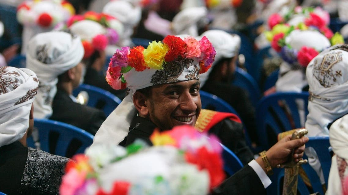 Yemeni grooms carrying swords and wearing colorful headgear celebrate during a mass wedding involving 250 couples. (Reuters)