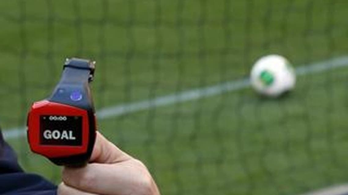 A FIFA official holds a wrist watch used as part of the Hawk-Eye goal-line technology. (Reuters)