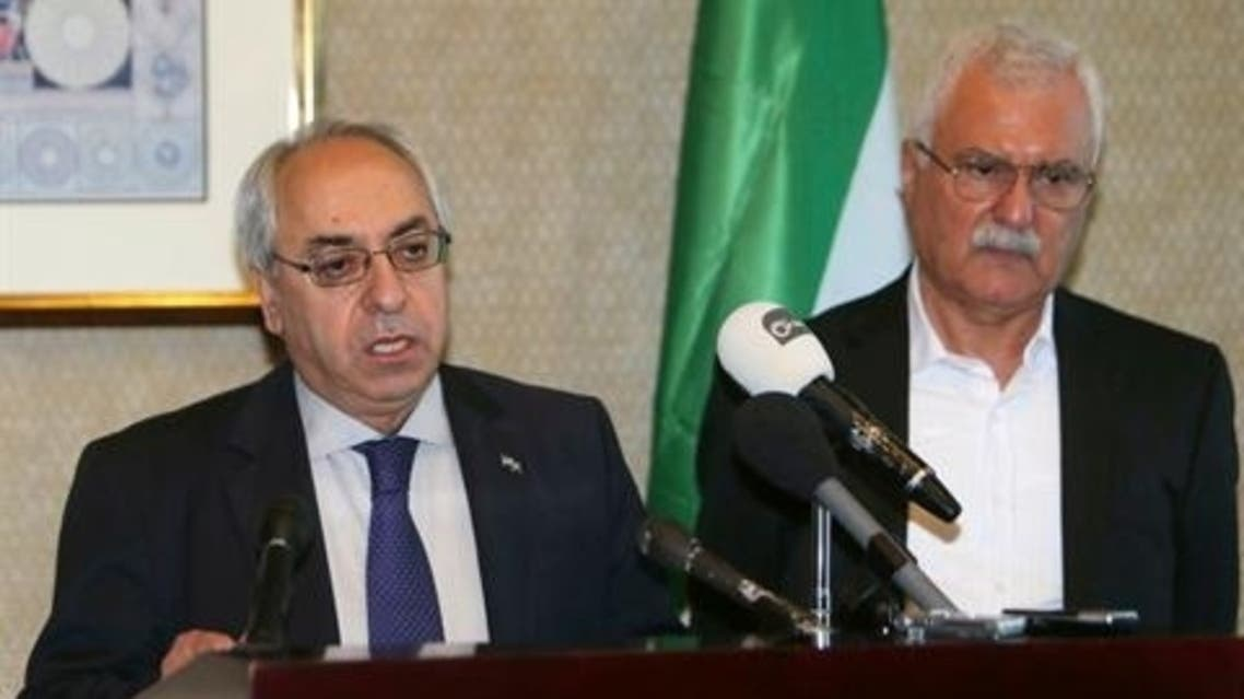 Syrian National Council (SNC) outgoing chief Abdel Basset Sayda (L) speaks next to new SNC chief George Sabra at a news conference in Doha November 10, 2012. (Reuters)