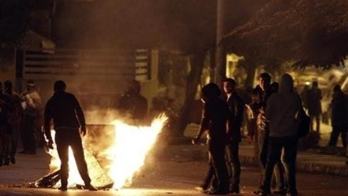 Egypt protesters attempt to close a road during clashes with riot police in front of the presidential palace in February. Similar scenes were seen on Saturday night in Cairo. (Reuters)