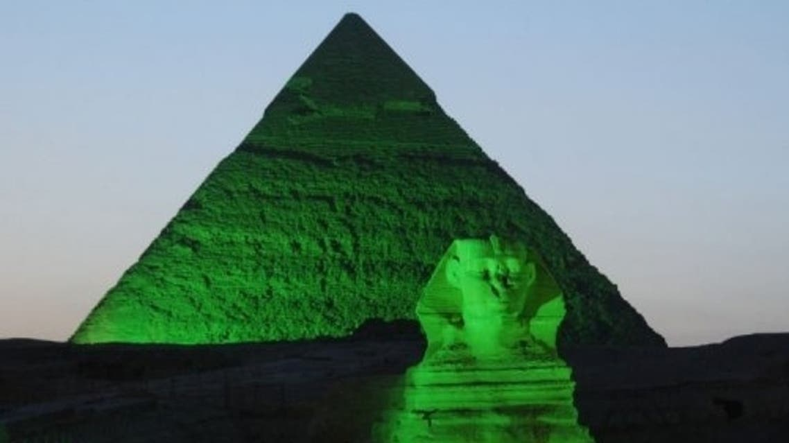 A Giza Pyramid and the Sphinx are lit with green light to mark St. Patrick's Day. (AFP)