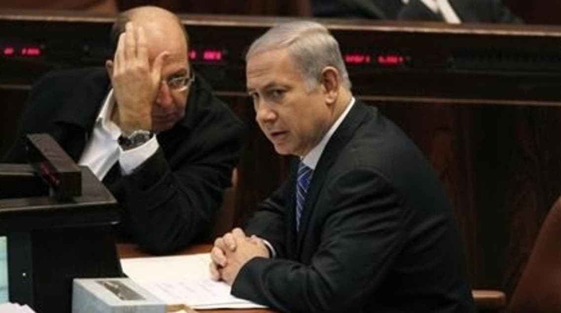 Israel's Prime Minister Benjamin Netanyahu (R) sits next to Vice Prime Minister Moshe Yaalon during a memorial service for the late Israeli Tourism Minister Rehavam Zeevi at the Knesset, the Israeli parliament, in Jerusalem November 2, 2011. (Reuters)