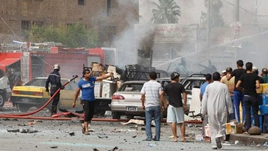 Residents gather at the site of a bomb attack in central Baghdad last year. (Reuters)