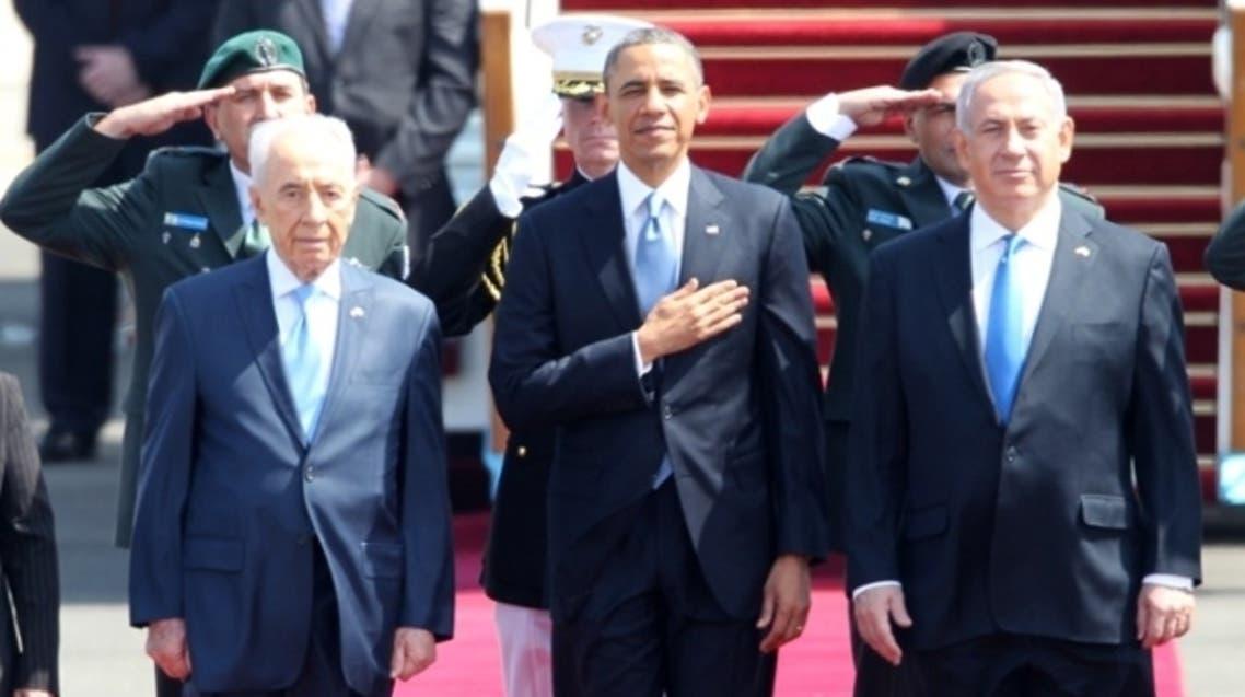US President Barack Obama, Israeli Prime Minister Benjamin Netanyahu and President Shimon Peres listen to the national anthem at Israel's Ben Gurion airport.