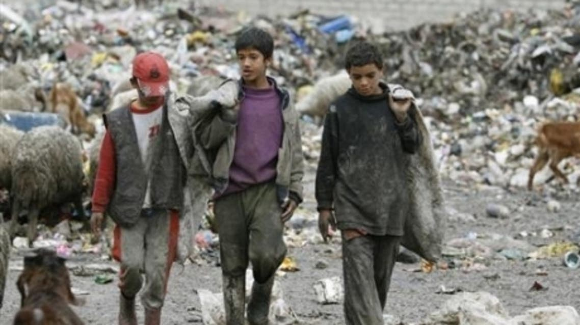 Iraqi teenagers walk in a rubbish dump in Sadr City, Baghdad, February 22, 2007. (Reuters)