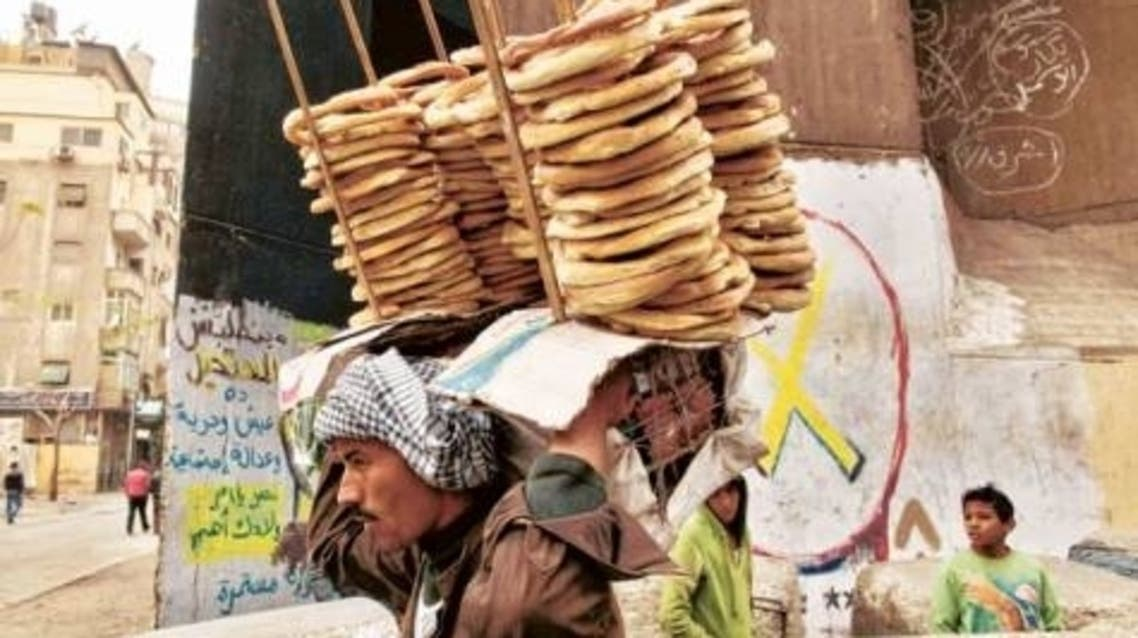 Egyptians struggle to meet their daily needs after government rationing bread