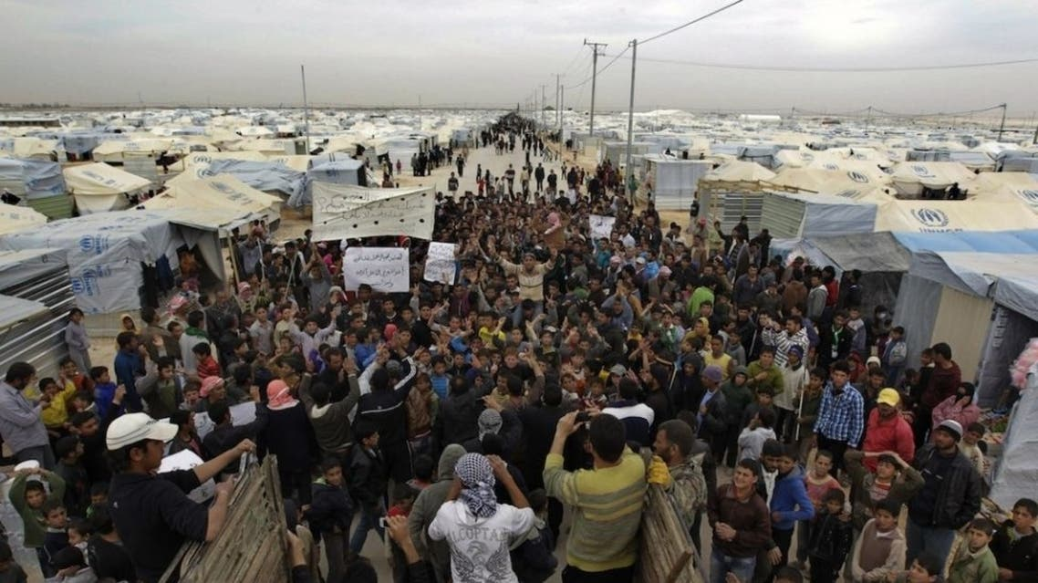Syrian refugees shout slogans during a demonstration at the Zaatari refugee camp in Mafraq, Jordan, on Feb. 22, 2013. (AFP)