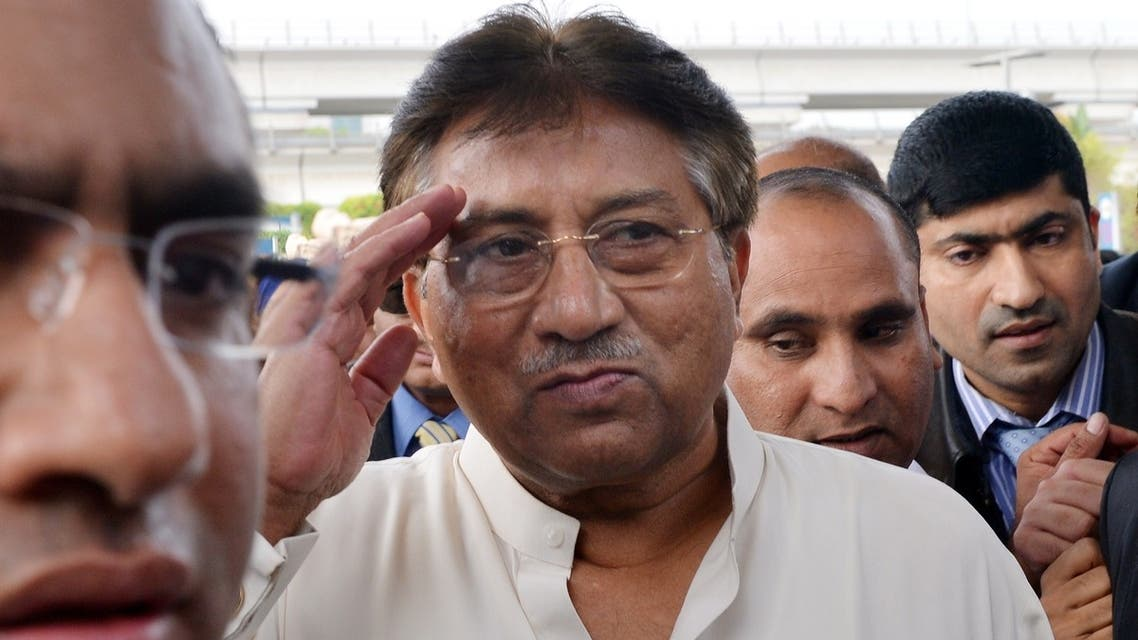 Pakistan's former military ruler Pervez Musharraf (C) arrives at the Dubai international airport before his departure to Karachi, in the Gulf emirate of Dubai on March 24, 2013. (AFP)