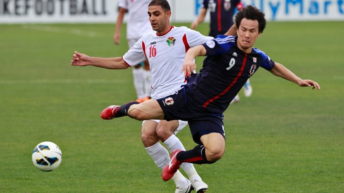 Japan's Shinji Okazaki (R) fights for the ball against Jordan's Basem Othman during their 2014 World Cup qualifying soccer match at King Abdullah stadium in Amman March 25, 2013. (Reuters)