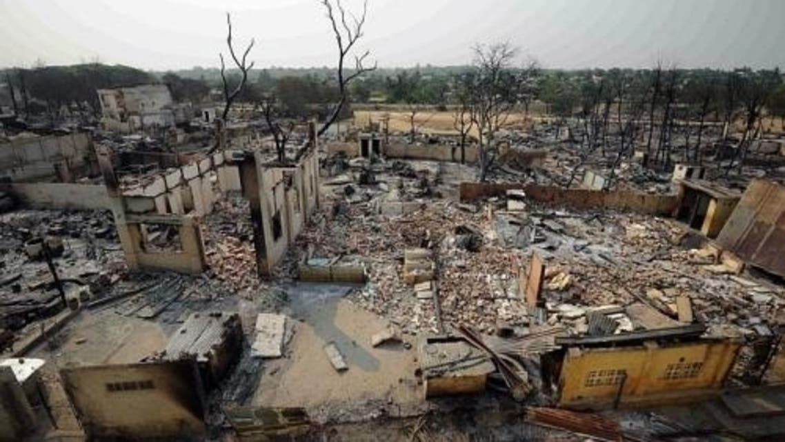 A general view of destroyed houses in riot-hit Meiktila on March 23, 2013. Dozens of houses and a mosque were torched as communal violence spread in central Myanmar. (AFP)