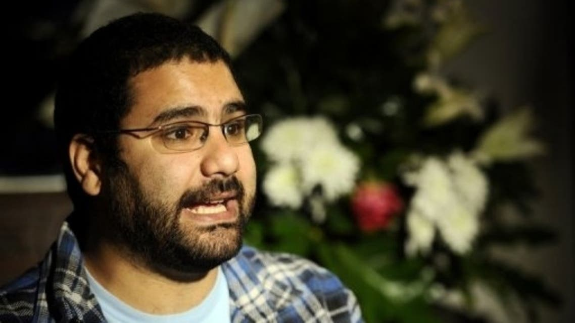 Egyptian blogger and activist Alaa Abdel Fattah speaks during a TV interview at his house in Cairo. (AFP)