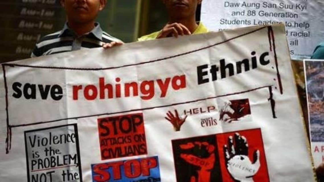 Ethnic Myanmar activists hold a placard during a protest against the Myanmar army in front of the Australia Department of Foreign Affairs and Trade (DFAT) in Sydney on March 19. (AFP)