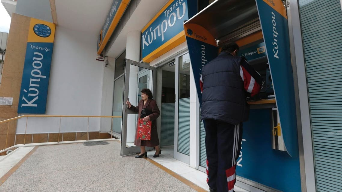 A woman leaves a Bank of Cyprus branch in Athens March 27, 2013. Cyprus confirmed banks would reopen on Thursday after a nearly two-week lockdown on the bailed-out country. (Reuters)