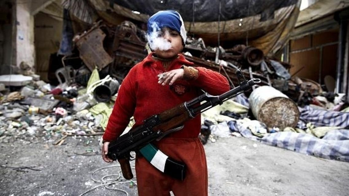 7 year old Syrian rebel poses with AK47