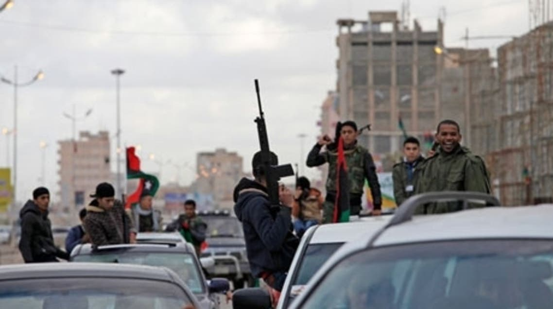 Libyans celebrate the second anniversary of the revolution in Benghazi. The city has become a no-go zone for foreigners. (The Associated Press)